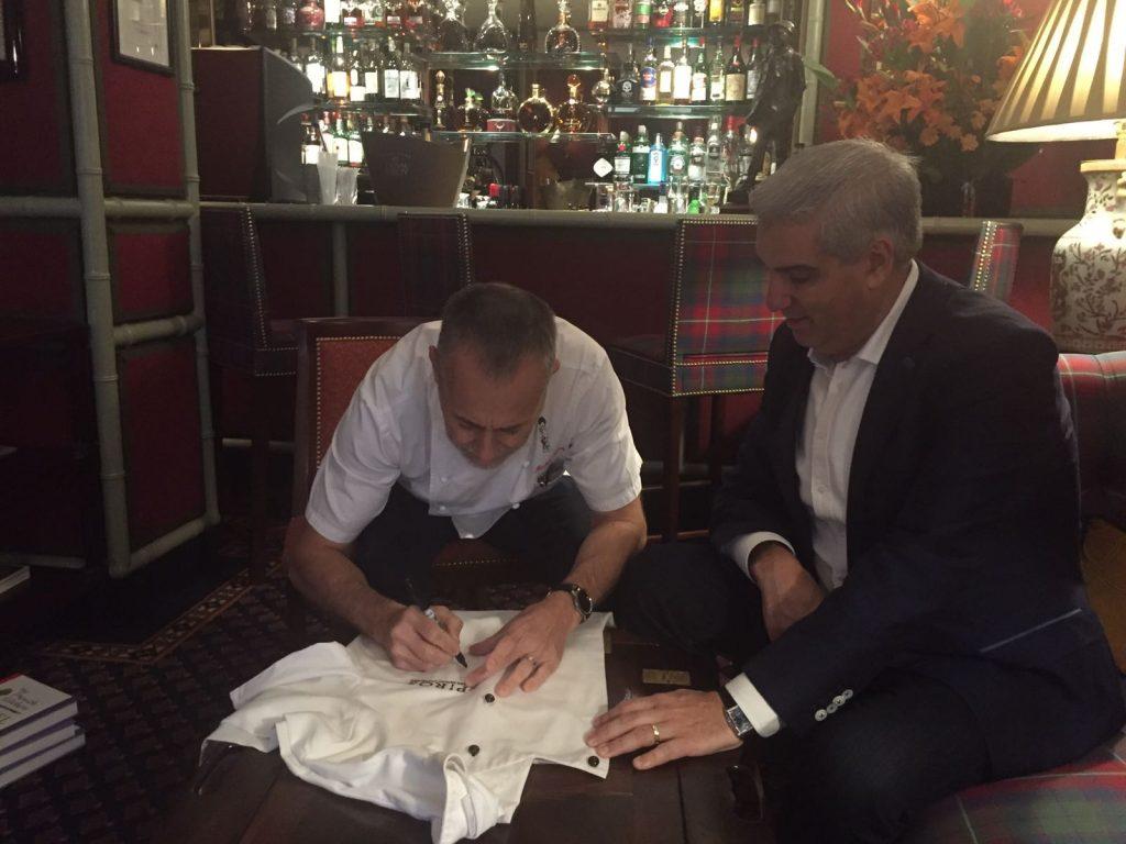 Michel Roux Jr signs Spiro's chef's whites