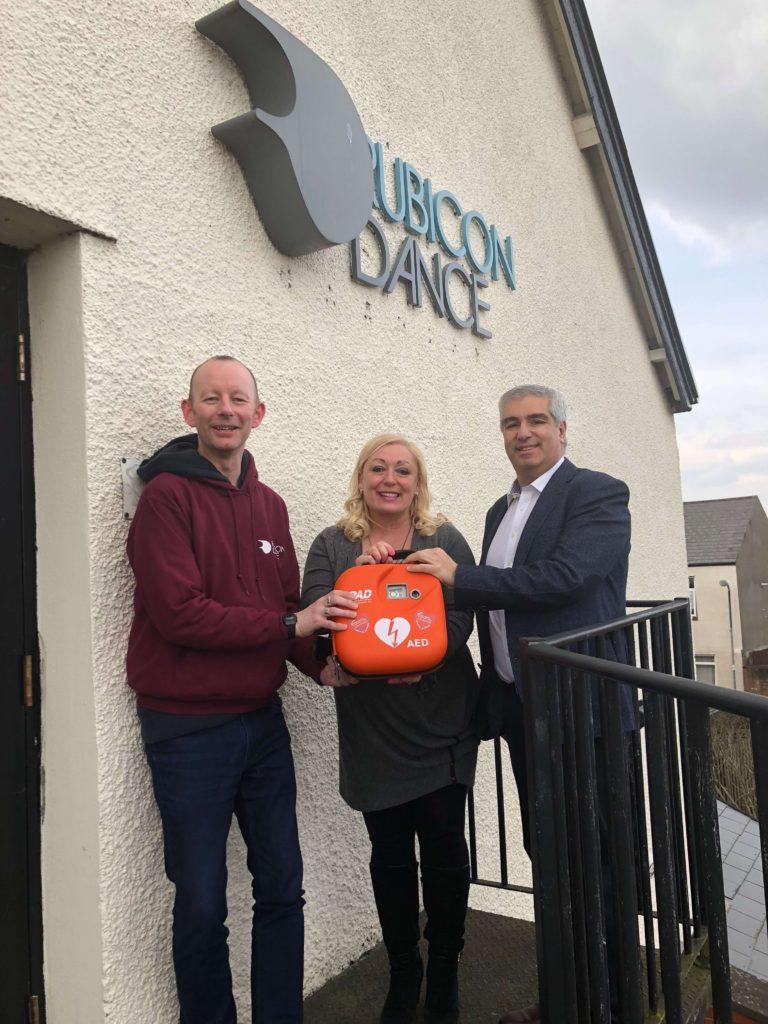 Spiros donates a defibrillator to Rubicon Dance Cardiff